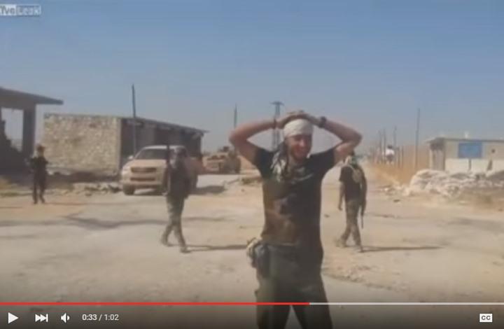 مليشيا شيعية عراقية تحرق جثة سوري في حلب (فيديو)