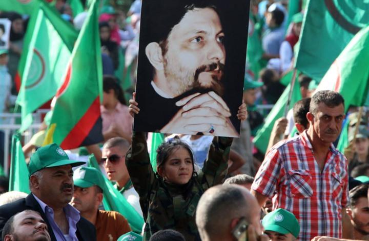 """أنصار """"أمل"""" يحرقون علم ليبيا ويهددون وفدها الاقتصادي (شاهد)"""