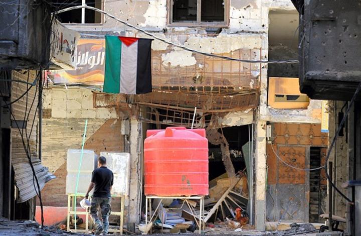 تنظيم الدولة يجبر المدنيين بمخيم اليرموك على إخلاء منازلهم