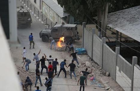 إصابات ومواجهات بحملة مداهمات واعتقالات بالضفة المحتلة