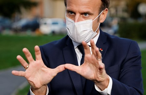 كاريكاتير ساخر عن ماكرون ينهي عقد رسام مع سفارة فرنسية (صورة)