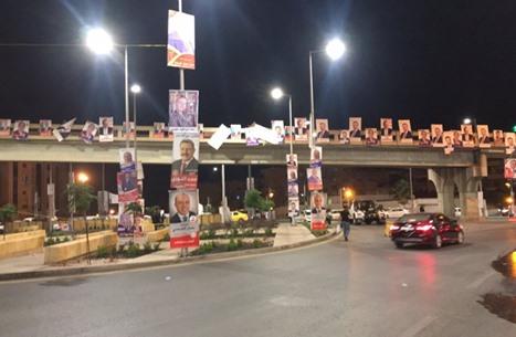 شوارع الأردن تتحول إلى معرض وعود وشعارات انتخابية