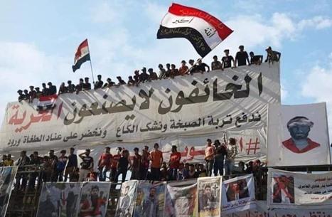 قتلى وجرحى بصدامات عنيفة بين محتجين وأنصار للصدر بالعراق