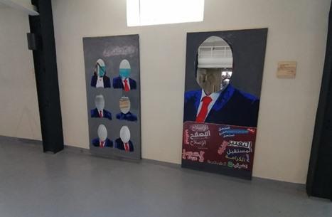 فنانون أردنيون يحولون اللوحات الانتخابية الى تحف فنية (شاهد)