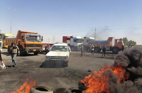 مذكرات توقيف بحق متظاهرين عراقيين في ذي قار