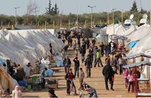 بلدية تركية تتبرع بملابس العيد لعدد من اللاجئين السوريين