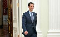 """نائب روسي يهدي """"الأسد"""" كتاب تاريخ مدرسي"""
