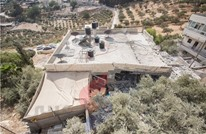 الاحتلال يفجر منازل منفذي العمليات الاستشهادية في القدس (صور)