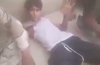 جنود عراقيون يعذبون طفلين نازحين من الموصل (شاهد)