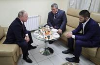 """بوتين يلتقي حبيب ويهنئه بعد تتويجه بلقب """"UFC"""" (شاهد)"""