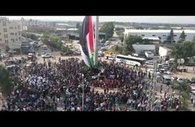 رفع العلم الفلسطيني على سارية بطول 60 مترا شمالي الضفة