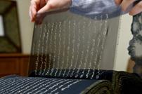 أول مصحف مكتوب على الحرير في العالم