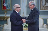 لماذا أثار لقاء ساويرس بالسبسي ونجله جدلا في تونس؟