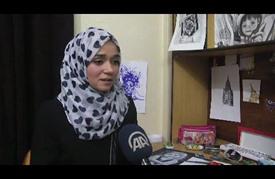 """فتاة من غزة ترسم """"لوحات حجرية"""" لدعم """"انتفاضة القدس"""""""