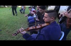 """""""دواوين"""" فرقة موسيقية بغزة تعيد إحياء الفن """"المُلتزم"""""""