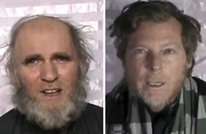 طالبان تبث تسجيلا مصورا لرهينتين أمريكي وأسترالي (فيديو)