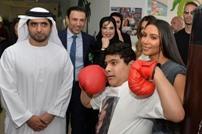 الإمارات تحقق بزيارة كيم كارداشيان لمركز معاقين في دبي