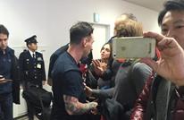 """الأرجنتينيون """"يبصقون"""" على ميسي في مطار طوكيو (صور)"""