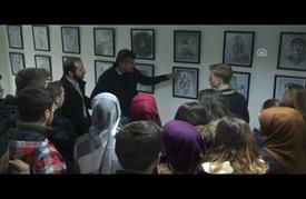 معاناة اللاجئين السوريين تتجسد في معرض رسومات بمقدونيا