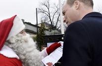 """الأمير وليام يسلم """"سانتا كلوز"""" رسالة من ابنه جورج (صور)"""