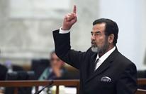 ما حقيقة الصورة المتداولة لصدام حسين قبيل إعدامه؟ (شاهد)