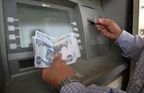 """""""كورونا"""" يجبر العراق على خفض قيمة الدينار أمام الدولار"""