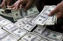 الدولار يهبط مع تراجع العائد على السندات الأمريكية