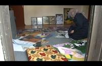 """رسامة سورية لاجئة تقاوم نظام الأسد بـ""""الريشة والألوان"""" (فيديو)"""