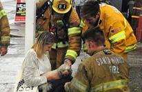 رجل إطفاء أمريكي يمنح كلبا قبلة الحياة (صور)