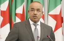 رئيس وزراء الجزائر يبرر تأجيل الانتخابات.. ودعوات للتظاهر