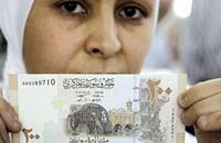 الاقتصاد السوري ليرة منهارة وديون متعثرة
