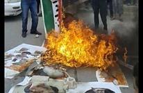 احتجاجات بالأردن ضد إيران.. إحراق صور الخميني وخامنئي (صور)