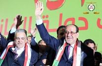 عراقيون يستقبلون دعاية المالكي الانتخابية بالأحذية (شاهد)