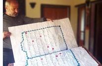 سوري يخط بيده نسخة من القرآن استغرقت ثلاث سنوات (صور)