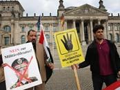 منظمات تطالب ميركل بربط العلاقة مع السيسي بملف حقوق الإنسان