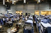 سجناء أمريكيون يصيبون أنفسهم بكورونا.. ما السبب؟