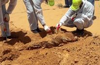 مقتل طفل وانتشال جثة من مقبرة جماعية جنوبي طرابلس