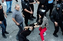 منظمة: استخدام السلطة قوات مدنية ضد المحتجين يضر بالسلم