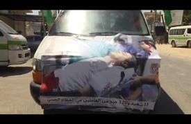 مسيرة لسيارات الإسعاف بغزة في الذكرى الأولى للحرب