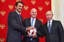 بوتين يسلم أمير قطر راية تنظيم كأس العالم 2022 (شاهد)
