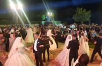 زفاف جماعي لـ15 عريسا يتحدى الأزمة الاقتصادية بلبنان (صور)
