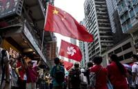 عشرات الآلاف في هونج كونج يطالبون بالديمقراطية