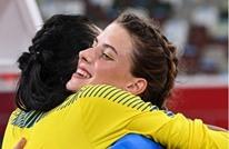 تصرف إنساني للاعبة أوكرانيا بالأولمبياد يتسبب في أزمة سياسية